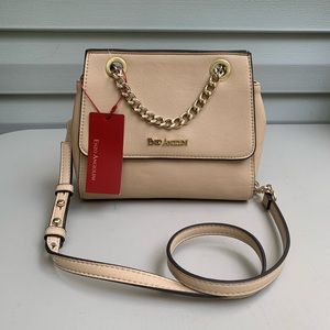 Enzo Angiolini mini beige crossbody bag.